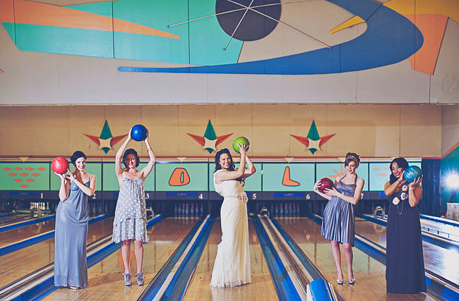 Hit the Lanes An old bowling alley makes for a funky-cool reception location and gives your guests a fun activity to boot. Photo by Our Labor of Love via Green Wedding Shoes