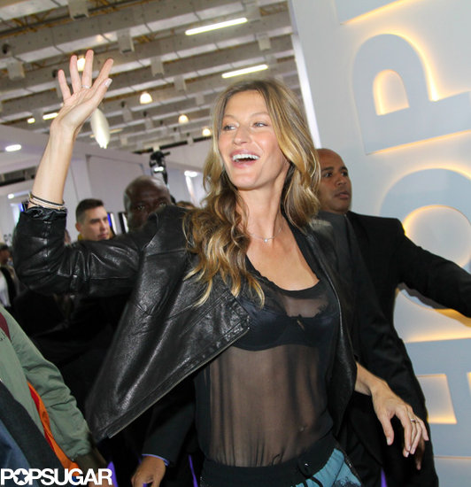 Gisele Bündchen wore a sheer shirt to launch her new lingerie line.