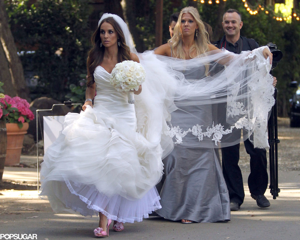 A bridesmaid helped Angela Stacy with her veil.