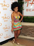 Solange lit up TAO Beach in a high-wattage mini by Boxing Kitten and gold metallic YSL sandals in 2010.