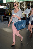 Kate Upton took to the streets of NYC wearing light-pink denim with a grey tee, bow ballet flats, and a blue tote bag.