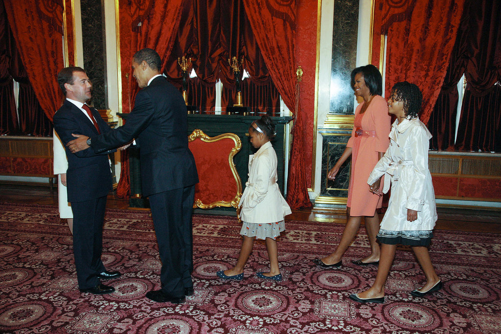 Then-President of Russia Dmitry Medvedev greeted the Obamas at the Kremlin before the leaders participated in a July 2009 summit.