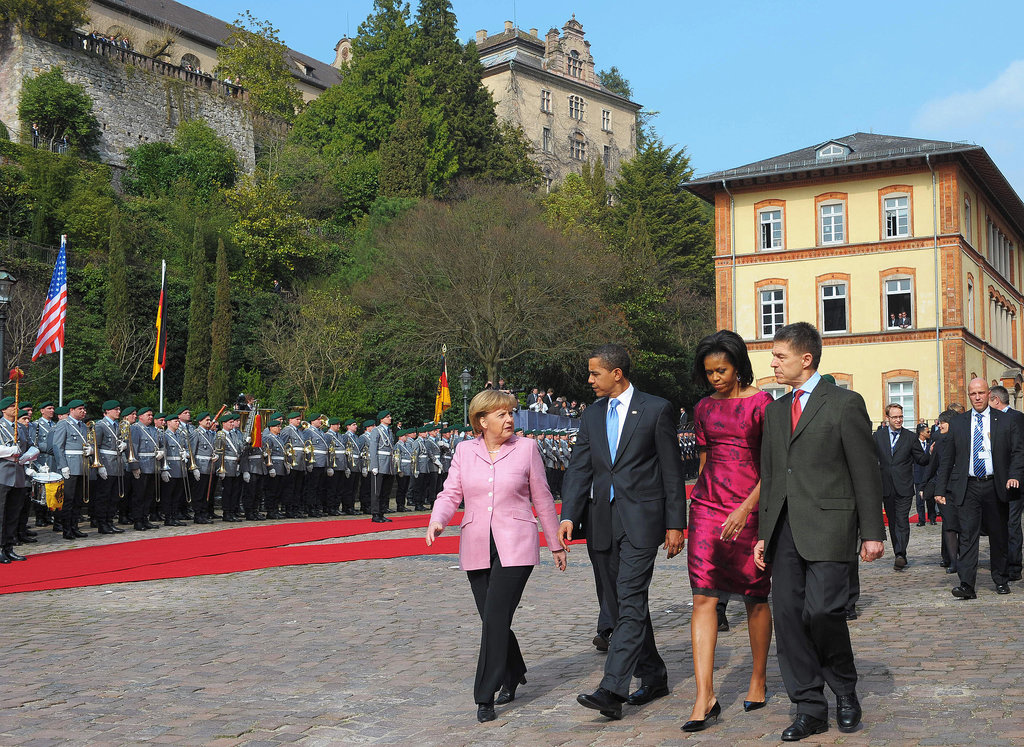 During an April 2009 NATO welcome ceremony, Barack and Michelle Obama walked with German Chancellor Angela Merkel and her husband, Joachim Sauer.