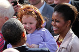 Barack and Michelle Obama greeted a young girl in Dublin, Ireland, during a public rally in May 2011.
