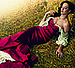 Katy Perry poses on hay for US Vogue.