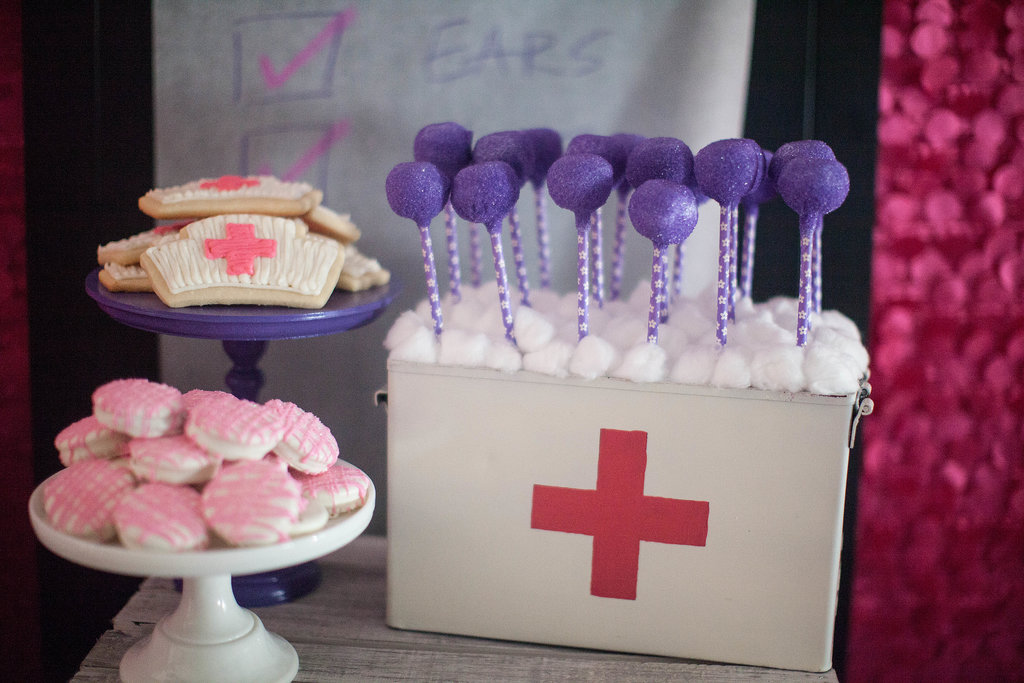 And purple sugared cake pops stuck out of a vintage medical supply box. Source: Jenny Cookies