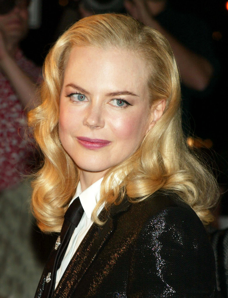 Back in 2003, Nicole was at the NY premiere of The Human Stain wearing her blond hair in glamourous vintage waves. She paired the feminine look with a tux for a modern twist.