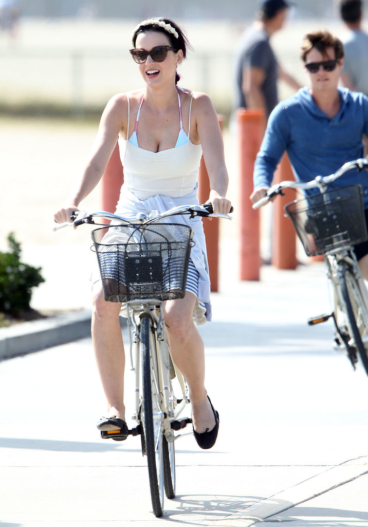 Katy Perry rode though Venice Beach, CA, with a friend in July 2012.