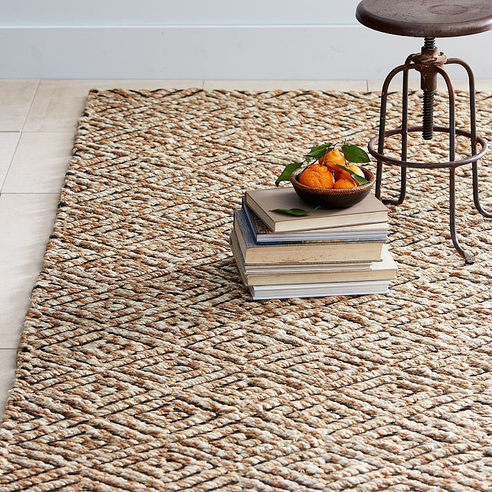 We're especially digging the diamond, braided detail on this jute rug ($279–$749). For Fall, try layering a small sheepskin or a vibrant dhurrie in autumnal tones.