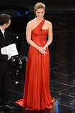 While on stage at the Festival di Sanremo in Italy, Bar Refaeli dazzled in a red one-shoulder gown and diamond jewelry.