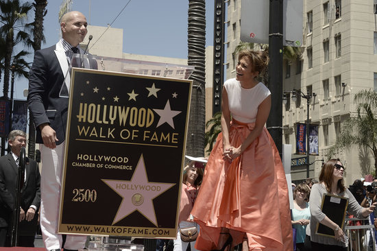 Jennifer Lopez laughed after Pitbull spoke during her Walk of Fame ceremony.