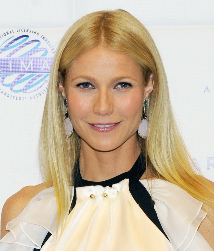 Gwyneth Paltrow was out this week with her sleek blond mane parted down the center and tucked behind her ears. Her makeup focused on her eyes with inky liner on her top lash line.