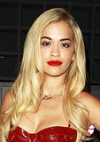 Rita Ora traded in her typically textured curls for smooth waves at the launch party for Sony Xperia Access in London. She paired the look with a glamorous red lip.