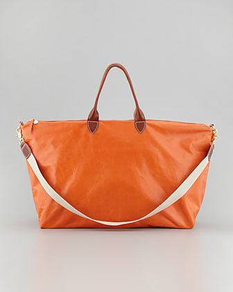 Clare Vivier's orange dyed leather weekender ($483) is a surefire way to get you noticed, plus it'll pop against a cool denim ensemble.