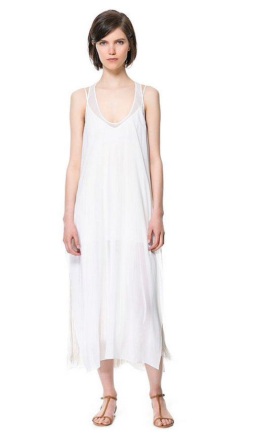 Every girl needs the perfect little white dress this Summer. Here it is, this Zara long studio dress ($90, originally $159).