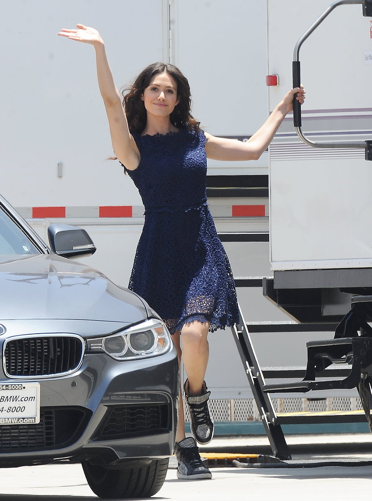 Emmy Rossum gave a wave on Monday while on the set of Comet in Los Angeles.
