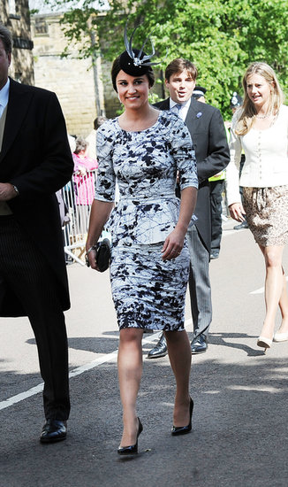 Pippa Middleton showed off her famous curves in a Tabitha Webb peplum dress, then added a fancy fascinator, at Melissa Percy and Thomas Van Straubenzee's wedding in the UK in June. We love her black and white palette and think it's totally appropriate for a black-tie wedding. The fascinator is optional but would give you that British touch.