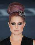 Kelly Osbourne mixed crimps and a starry hair accessories for this punk-chic topknot at the Met Gala.