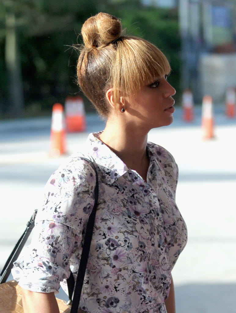 Beyoncé Knowles left her blunt fringe out for this easy topknot look.