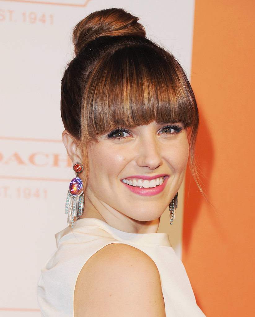 Sophia Bush played with texture and shape with this flattened topknot style, allowing her blunt fringe to take centre stage.