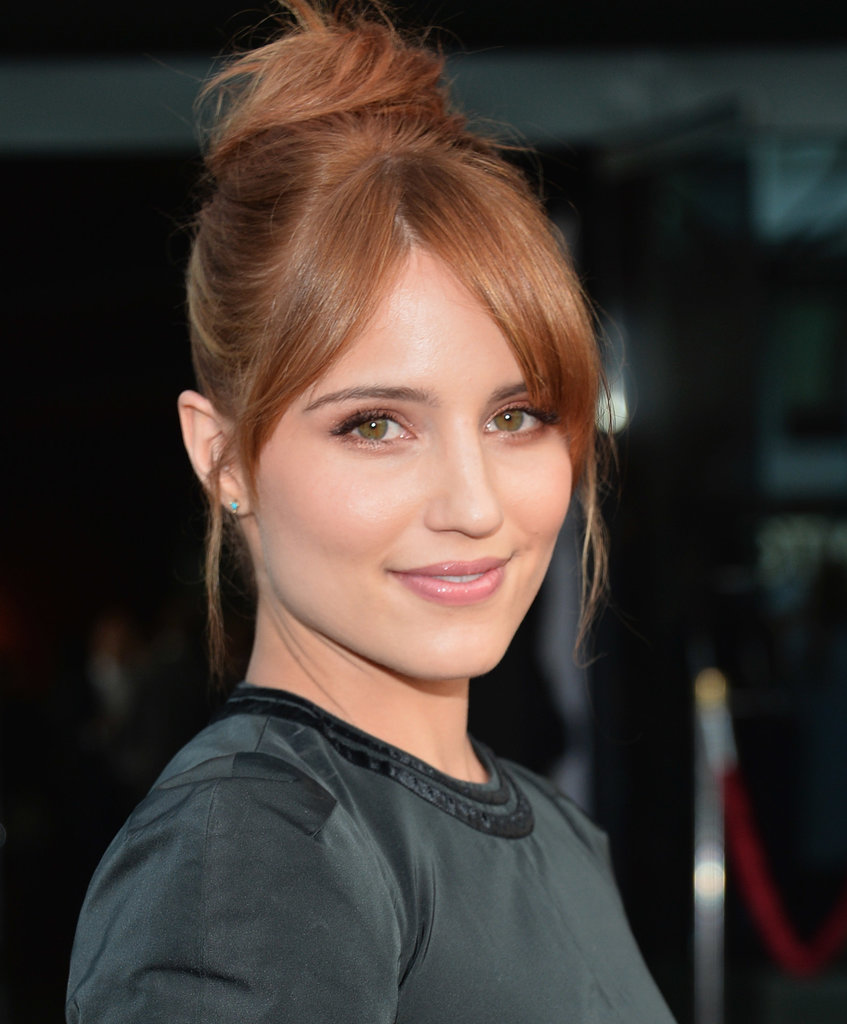 If your fringe won't pull back into your topknot, let it hang out. Dianna Agron split her grown-out fringe down the middle for a relaxed feel.