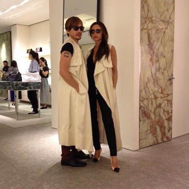 "Victoria Beckham and Ken Paves asked the question ""who wore it best?"" while trying on the same long vest. Source: Instagram user victoriabeckham"