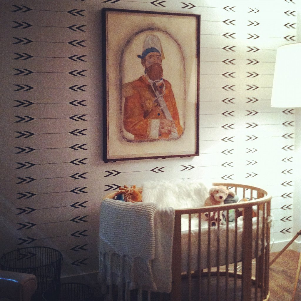 The chic nursery featured wallpaper from Cavern and art by Frohawk Two Feathers, on loan from the Taylor de Cordoba gallery.