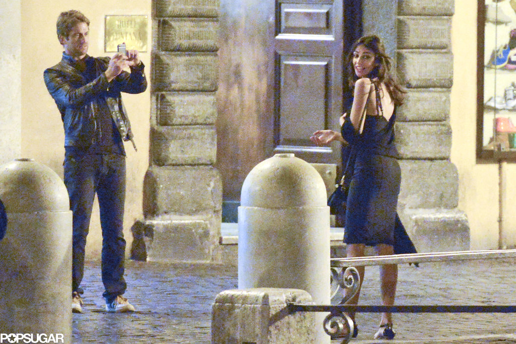 Gerard Butler snapped photos of Madalina Ghenea.