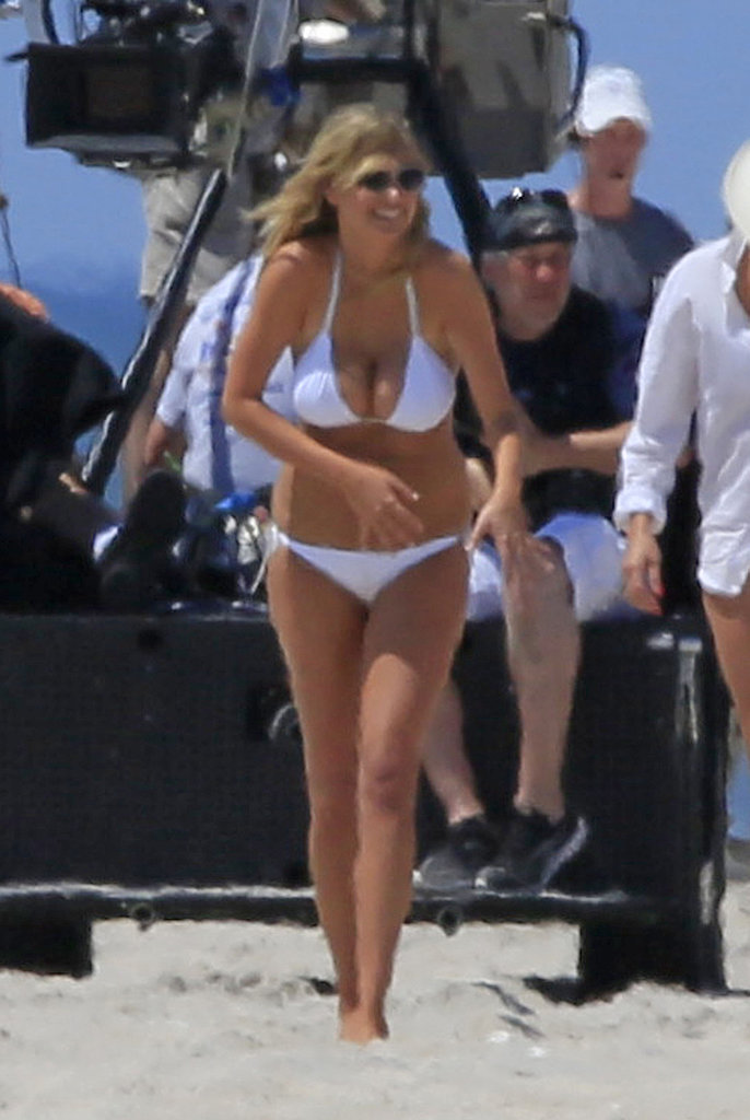 Kate Upton wore a tiny white bikini while on the set of The Other Woman in the Hamptons in June.