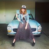 Lily Cole posed on a classic car in a girlie outfit and street-chic baseball cap. Source: Instagram user lilycole