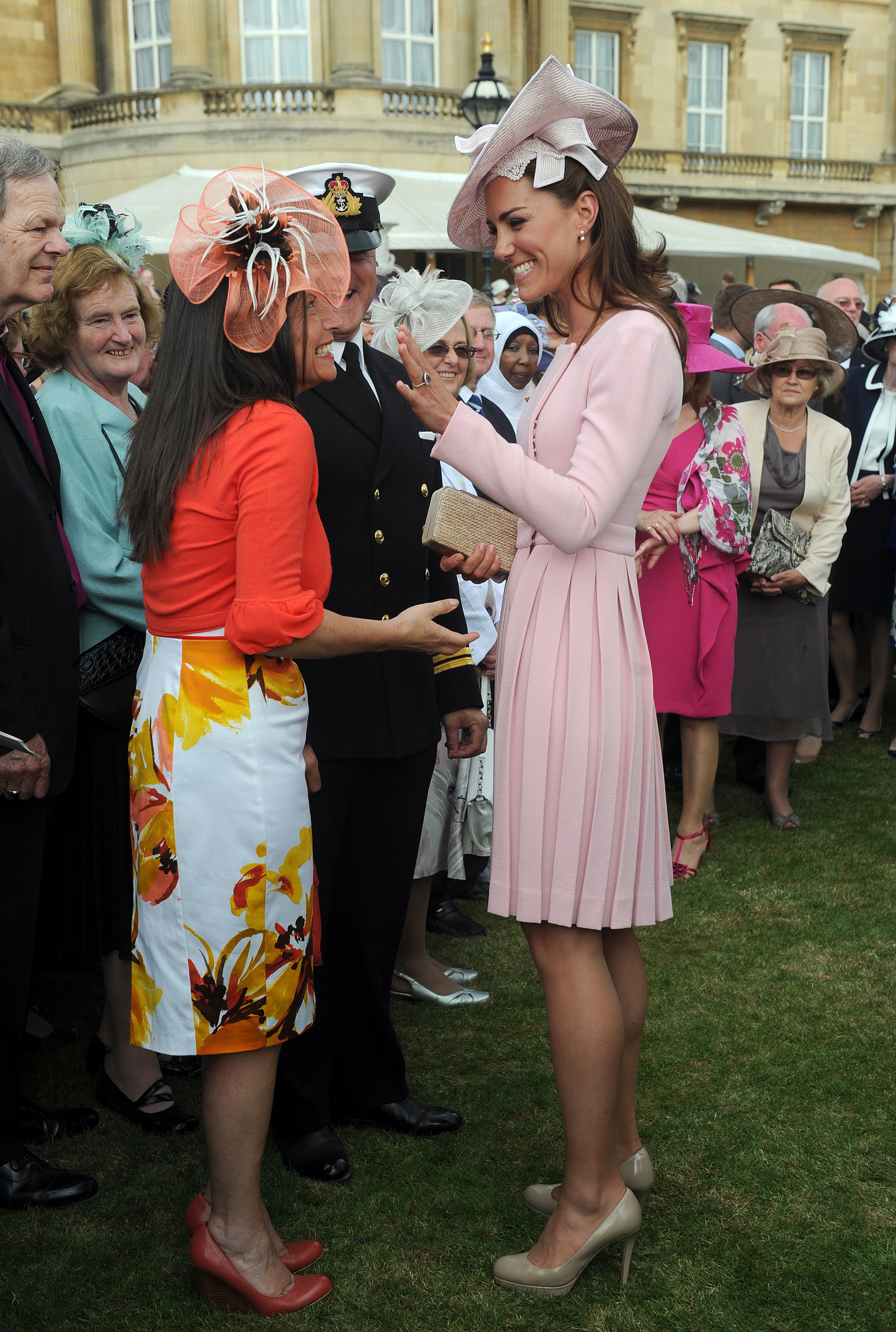 She went for a pink ensemble at the May 2012 garden party at Buckingham Palace.