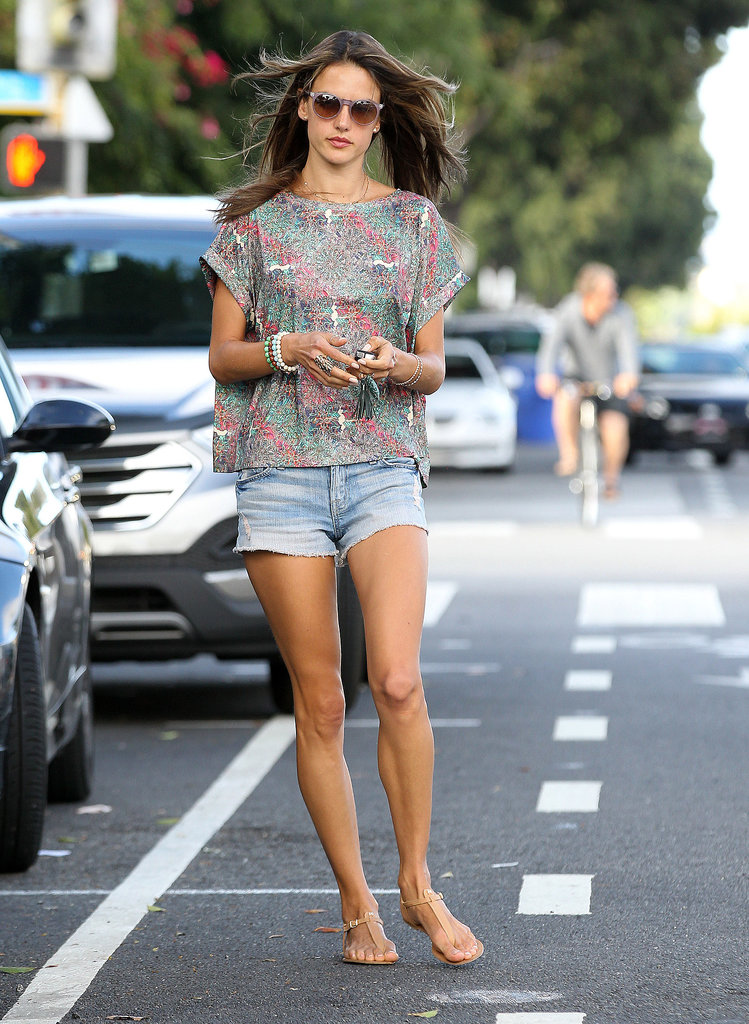 Alessandra Ambrosio's printed Whitney Eve tee and round sunglasses stole the spotlight in her summery LA style.