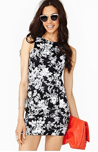 We'd style this Nasty Gal Marcelle Floral Dress ($48) just like this — and punch it up with a little high-impact arm candy for a night out.