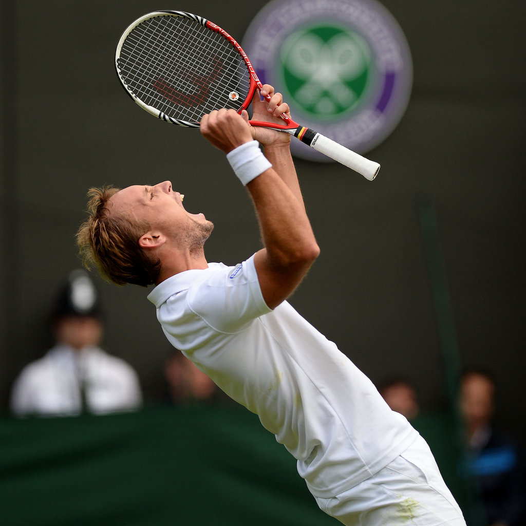 Belgium's Steve Darcis cheered after winning his first round match against Rafael Nadal during the Wimbledon Championships in London.