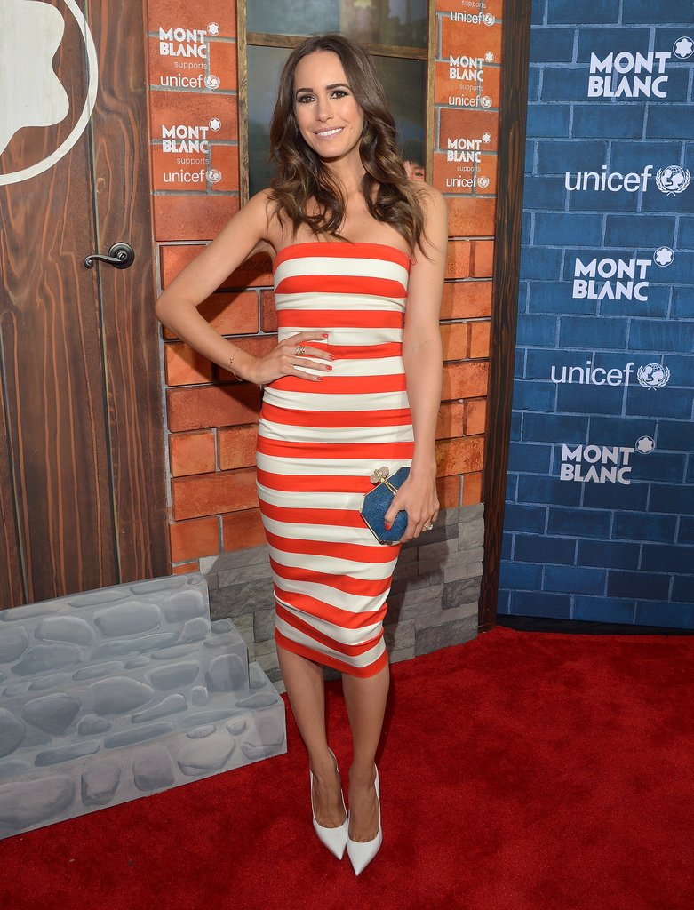 Go fancy in a red-and-white striped dress, white pumps, and a blue clutch like Louise Roe did at an event in LA.