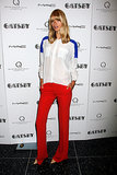 Model Julia Stegner's two-toned blouse and shocking red trousers would make quite the unique Fourth of July look. If you don't own a two-toned blouse, just style a white blouse with a blue scarf.