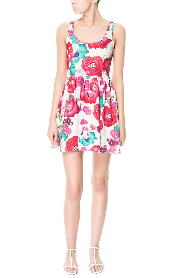 This bright Zara Neon Print Dress ($40) practically screams Summer.