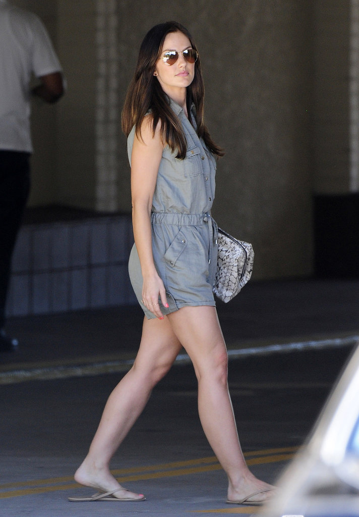 Minka Kelly sported this Vince Camuto utility romper ($60, originally $129) with a printed clutch, nude flip-flops, and aviator sunglasses in LA.