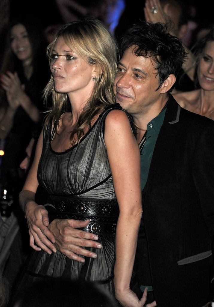 Jamie Hince held on to Kate Moss as they enjoyed a benefit concert in London in June 2013.