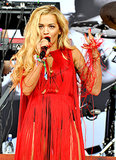 Rita Ora wore bright red for her festival performance.