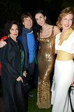 Mick Jagger was flanked by his ex-wife, Bianca Jagger, his current girlfriend L'Wren Scott and their friend Julia Peyton-Jones when they partied together at the Serpentine Summer Party at Hyde Park in London on June 25.