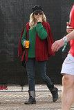 Sienna Miller kept warm in a cape.