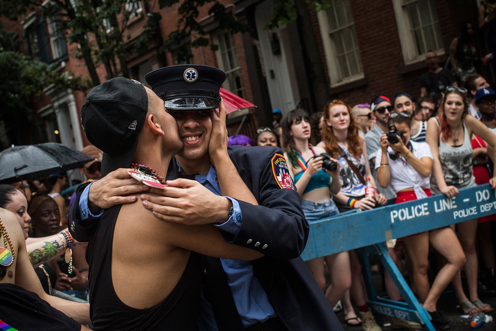 Two men shared a kiss during the NYC Gay Pride Parade.