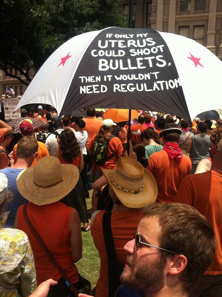One woman held up an umbrella painted with her message. Source: Twitter user rketexas