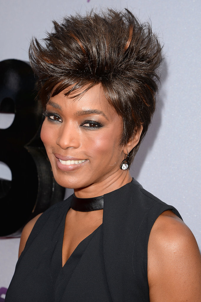 Angela Bassett's look for the night was infused with a rock-star flair thanks to her hair spiked upwards and dark smoky eye makeup.