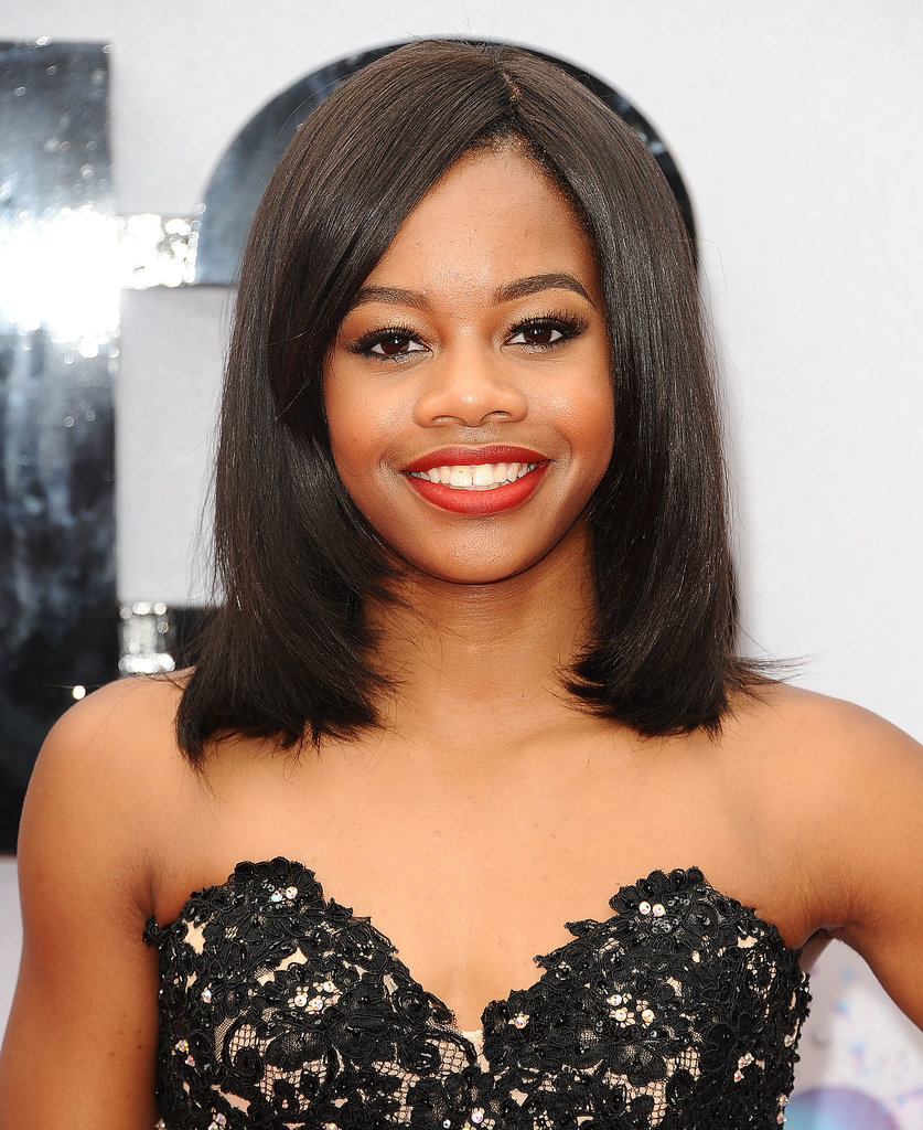Olympian Gabby Douglas went for glamour with a classic red lipstick and a sleek lob to accent her lace sweetheart neckline.