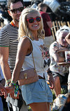 With the weather seemingly warmed up, English celeb Katherine Jenkins paired denim shorts with a knotted tee.