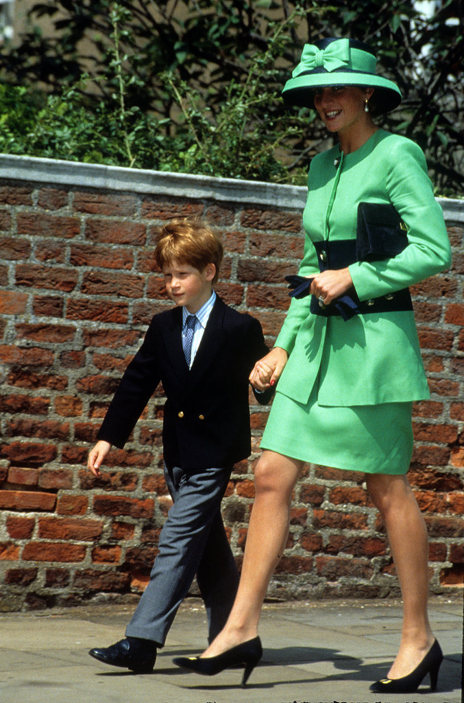 In July 1992, a chic Princess Diana walked hand in hand with Prince Harry in Windsor, England.
