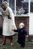 Prince William held onto Princess Diana's hand while walking through the gardens of Kensington Palace in December 1983.