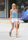 Rosie Huntington-Whiteley created a simple yet stunning Summer pairing: a denim tank with white denim cut-offs, taupe booties, and a basket purse.